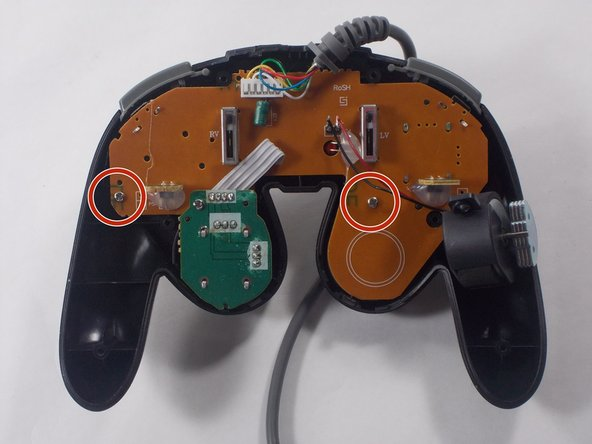 Hold the controller as shown in the picture so that you can remove the circuit board.