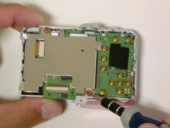 Remove all screws from the screen plate, using a #00 Philips screwdriver.
