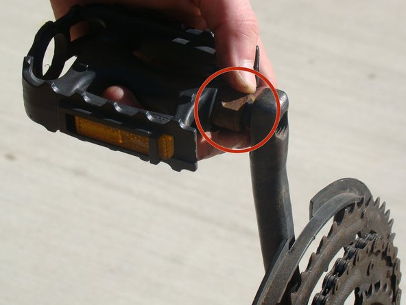 Locate the 15mm pedal nut, and position the crank arms for maximum leverage.