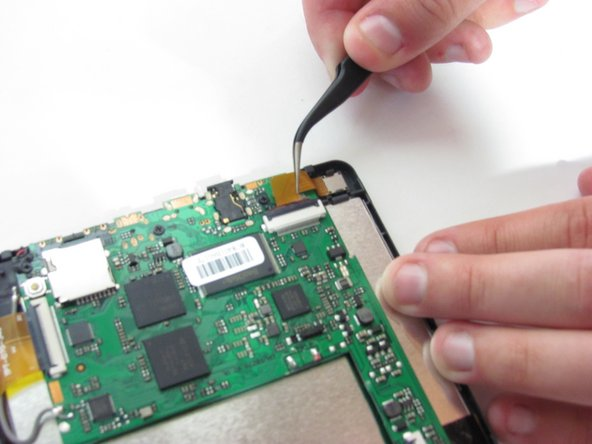 Image 3/3: Use tweezers to remove the ribbon cables from the zift connectors.