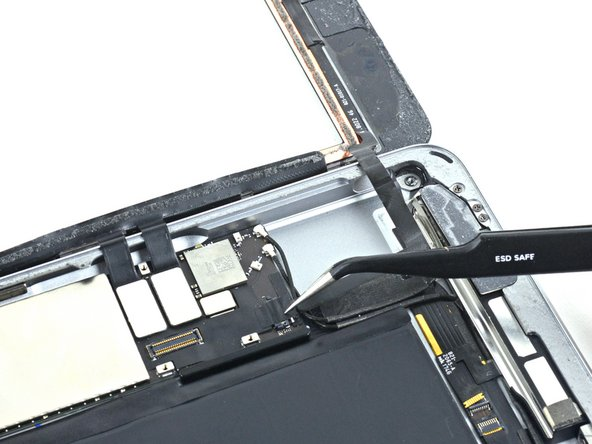 Remove any tape covering the home button ribbon cable connector.