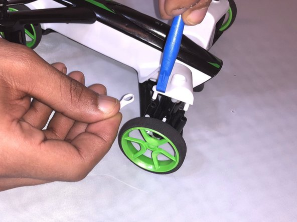 Remove the connector of the drone body and the back wheels using a plastic opening tool.