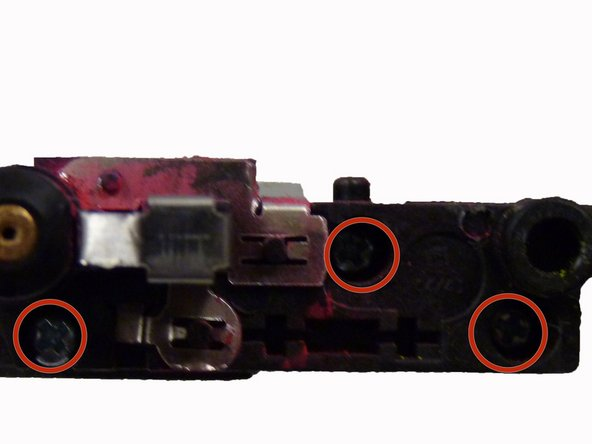 Remove these three screws from the right end of the toner transfer unit.