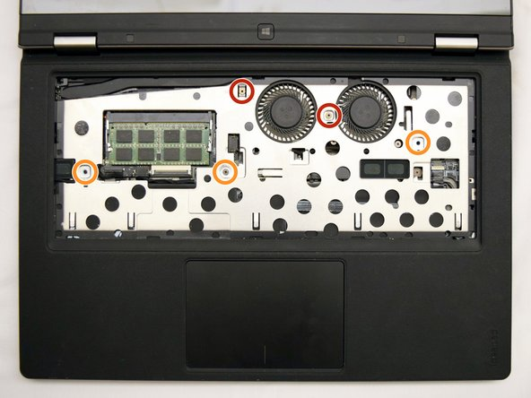 Locate and remove the screws holding the bezel to the laptop body: