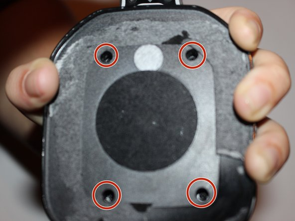 Remove the four 7mm screws with a Phillips #1 screwdriver.
