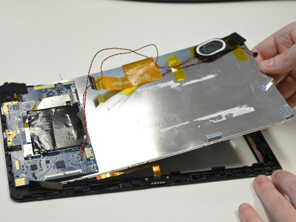 Carefully slide out the metal slate and LCD screen from underneath the motherboard.