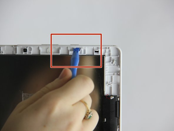 Depress power switch using finger, and simultaneously pry in same direction with a plastic opening tool.