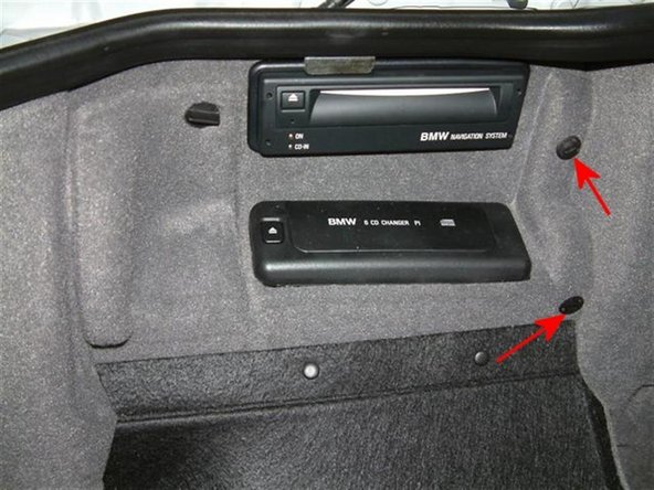 Remove the plastic trunk liner screws to gain access to the wiring behind the navigation computer