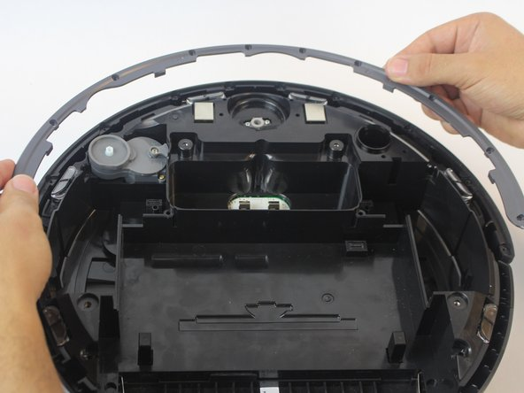 Lift the bottom guard off the front sensor panel by pulling it upwards.