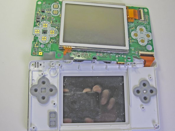 The ribbon cable and two other wires are still connected to the motherboard. The right and left bumpers tend to fall out.