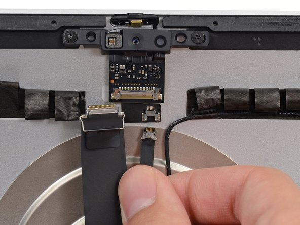 Pull the microphone cable connector straight down out of its socket on the camera board.