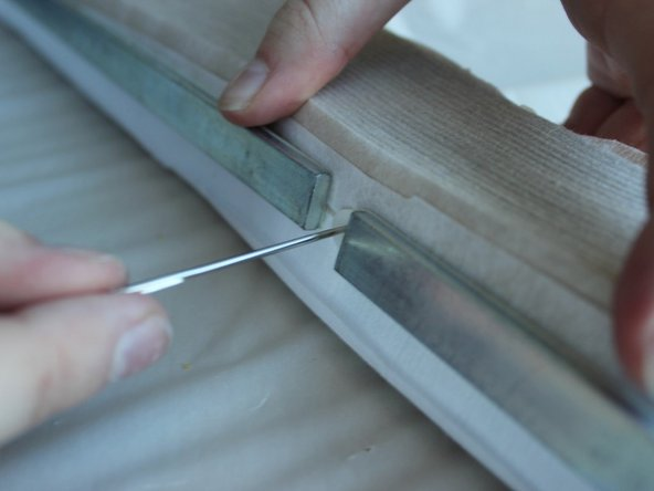 Pull the needle and thread through the shade, making sure to leave three inches out of the bottom side of the shade.