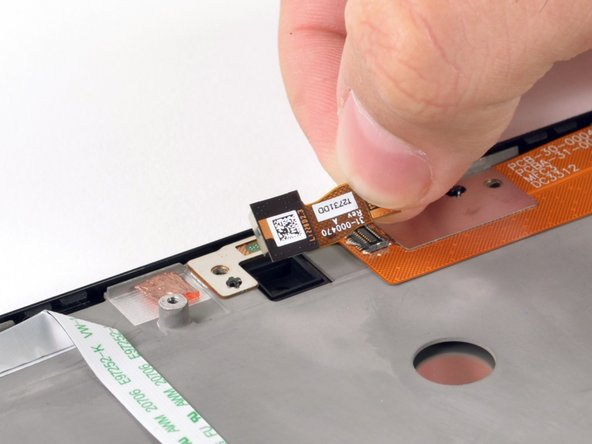 Image 1/2: Remove both screw which secure the flat metal to the gray casing.