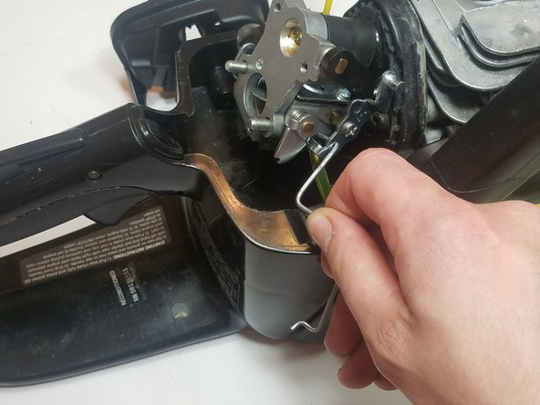 Disconnect and remove the throttle linkage from the carburetor
