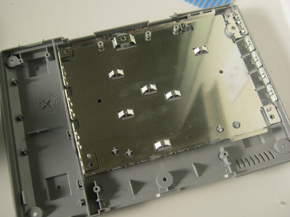 Lift the RF shield out of the case.