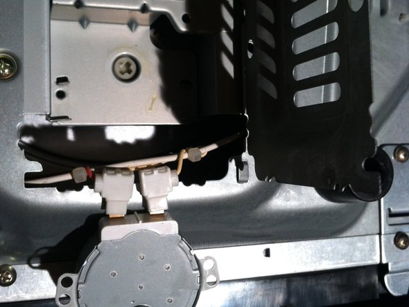 Image 1/1: Carefully swing your new access door open. Be careful there can be really sharp edges. Here the motor has already been removed.
