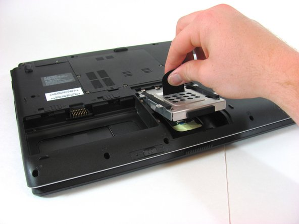 Lift up the black tab to expose hard drive.