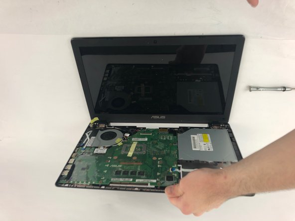 Flip the laptop over, so it is sitting as   it would if you were using it