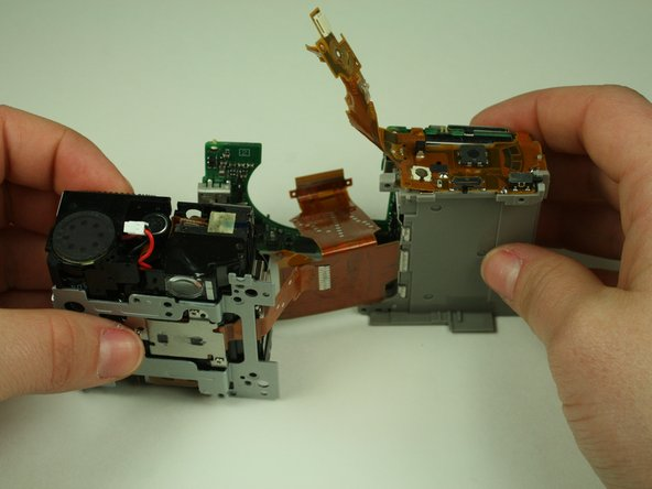 Separate the battery compartment and the lens-flash assembly.