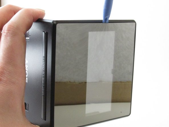Image 2/2: Use the plastic opening tool to separate the screen from the device.