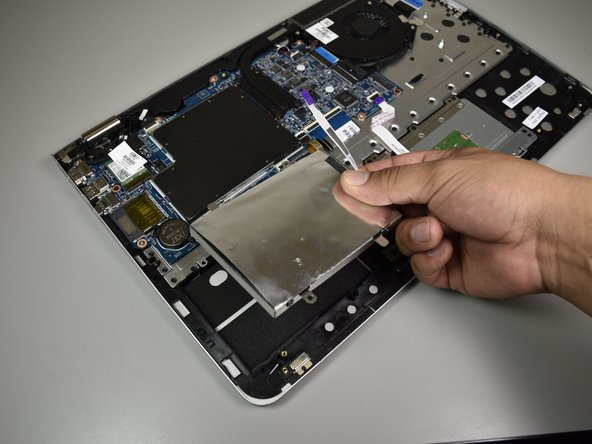 Use your hands to lift the hard drive up and remove it.