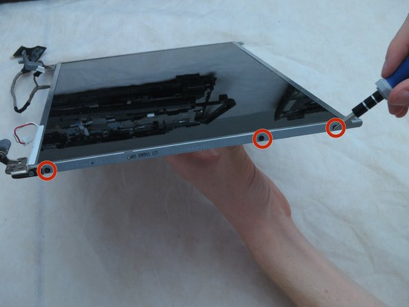 Using a Phillips #1 screwdriver, remove the six 3-mm screws from the sides of the screen. There should be three on each side.