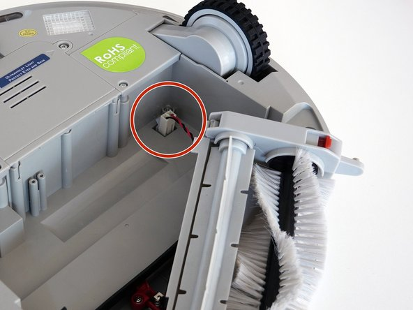 Image 1/3: Remove the 4 screws located beneath the brush compartment.