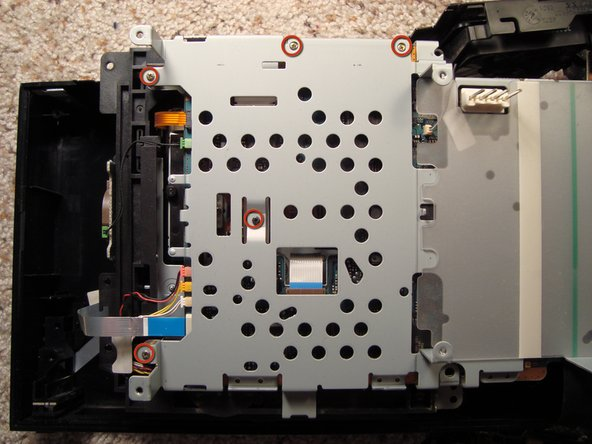 Done that we can unlock the optical drive from the metal frame.