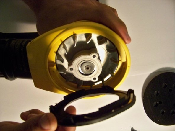 When the disc pad is removed, the brake is located directly under it.  Remove the brake from the sander.