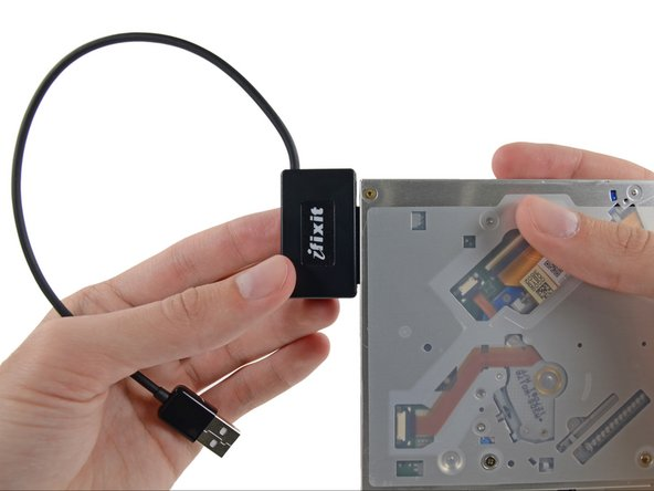 Image 2/3: Align the cable's SATA connector with the drive's port and plug in securely.