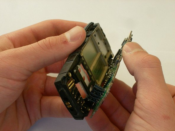 Carefully pull apart the casing from the circuit board.