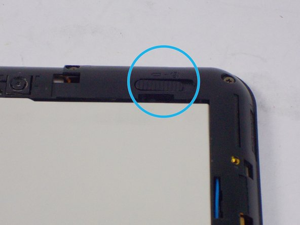 Use your fingers to push the release switch, which is located at the top right corner of the device to the right.