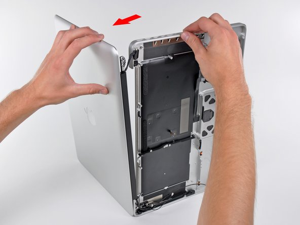 Image 2/3: Lift the display up and away from the upper case, minding any brackets or cables that may get caught.