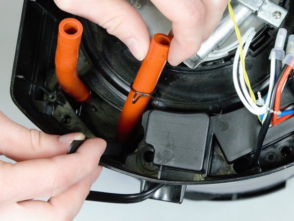 Once the clamp is free, gently pull upwards on the hose to remove it.