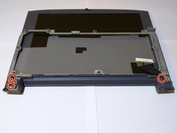 Image 1/1: Using the phillips screw driver remove the final 3 screws securing the screen