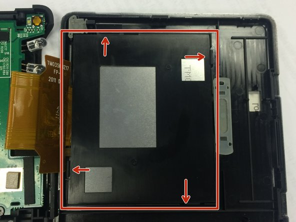 Image 1/1: Loosen screen backing by pushing back on plastic clips that are holding the black screen backing in place.