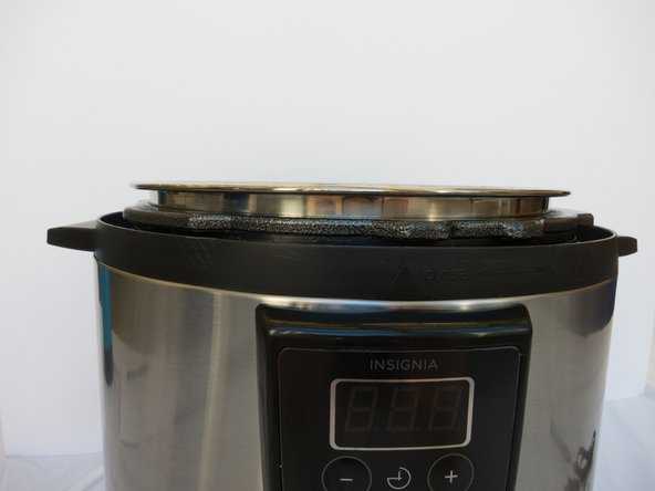 Remove the lid from the pressure cooker's base.