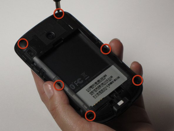 To remove the back casing inside the phone, unscrew the 6 screws that are around the perimeter of the phone.
