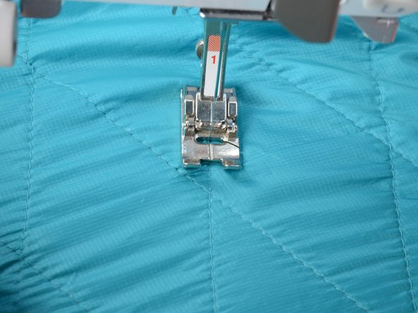 Continue sewing until you overlap five of the remaining stitches.