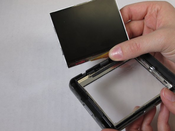 Remove the strip of orange tape from the LCD screen to detach the LCD screen from the front casing.