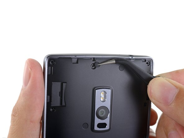 The OnePlus 2 hits back as we find even more screws hidden away beneath rubber covers.