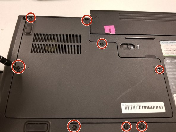 Remove the 2mm screws on the backside of the laptop using a J0 screwdriver.