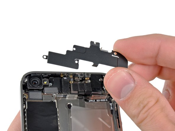 Image 3/3: Remove the Wi-Fi antenna from the iPhone. Make sure you don't lose the metal clips on the top of the cover where the 4.8mm screw attaches or the 4.8mm screw. That's the primary reason for abnormal Wi-Fi performance after the reassembly.