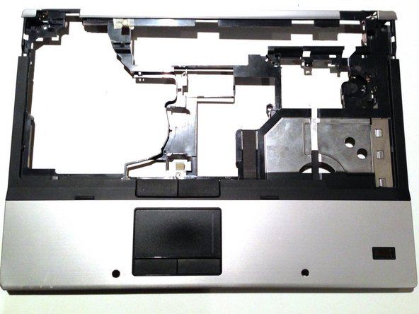 Lift the rear edge of the top cover until it separates from the base of the laptop and lifting it straight up.
