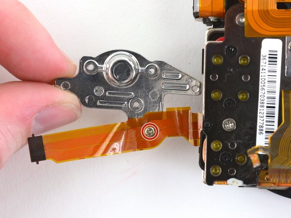 Image 1/3: Use tweezers to remove the small copper ring underneath the screw.