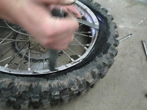 Once you have it pulled go about 5 inches down the rim and use the same leverage idea. Once you have it pulled away take the first spoon out and move 5 inches again and wedge it again. Repeat this step until one side of the tire is off the rim.
