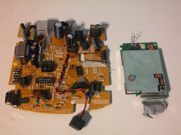 All of the cables to the main board can now be cut and the wireless module can be cut off of the main board.