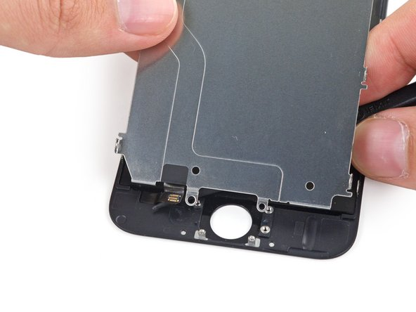 Image 2/3: Remove the LCD shield plate.