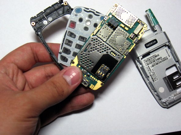 Image 1/2: Once the logic board is removed, the keypad can be easily popped out from the frame with very little force.