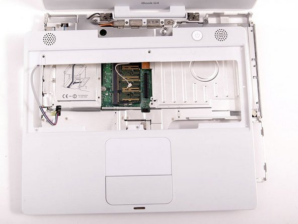 Carefully lift the upper case about half of an inch and move it so that you can access the power and speaker cables.